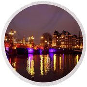 City Scenic From Amsterdam With The Blue Bridge In The Netherlands Round Beach Towel