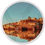 Cityscape For The Beautiful Nubian City Aswan In Egypt At The Golden Hour Of The Sunset Time. Round Beach Towel