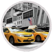Classic Street View Of Yellow Cabs In New York City Round Beach Towel
