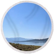 Clear Blue Skies Over Turquoise Lake Waters Round Beach Towel