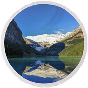 Clear Reflections In The Water At Lake Louise, Canada. Round Beach Towel