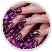 Closeup Of Woman Hands With Purple Nail Polish Round Beach Towel
