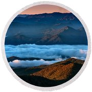 Clouds In The Valley Round Beach Towel