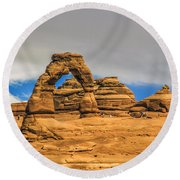Clouds Over Delicate Arch Round Beach Towel