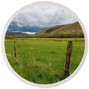 Clouds Over The Hills Round Beach Towel