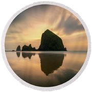 Cloudy Sunset At Cannon Beach Round Beach Towel by James Udall