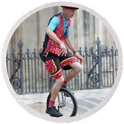 Clown Riding Unicycle In Town Round Beach Towel