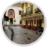 Cobblestone Argote De Molina Street With Cafe Ending At The Nort Round Beach Towel