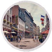 Cobblestone Streets In Old Montreal  Round Beach Towel