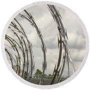 Coils Of Razor Wire On Fence Round Beach Towel