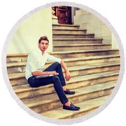 College Student Sitting On Stairs, Relaxing Outside Round Beach Towel