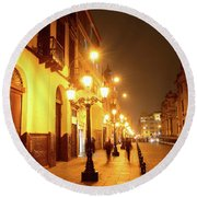 Colonial Street In Central Lima At Night Round Beach Towel