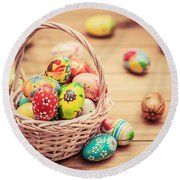 Colorful Hand Painted Easter Eggs In Basket And On Wood Round Beach Towel