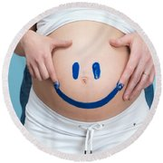 Couple Painting A Smiley On A Pregnant Woman's Belly Round Beach Towel