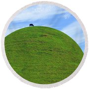 Cow Eating On Round Top Hill Round Beach Towel