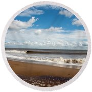 Cumulus Clouds Passing Across The Beach At Skegness Lincolnshire England Round Beach Towel