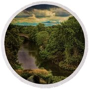 Dark Skies Over The Avon Round Beach Towel