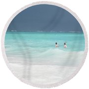 Dark Skies Over Aquamarine Washed Waves Round Beach Towel
