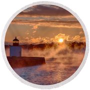 Dawn Peeking Over At Derby Lighthouse Round Beach Towel