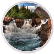 Dawn Upon Swiftcurrent Falls  Round Beach Towel
