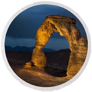 Delicate Arch At Night Round Beach Towel by Adam Romanowicz