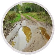 Dirty Autumn Road With Brown Pools After Rain Round Beach Towel