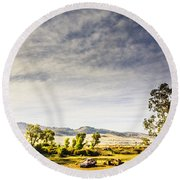 Distant Car Wrecks On Outback Australian Land  Round Beach Towel