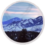 The Distant Peaks Of Pikes Round Beach Towel