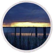 Distant Storms At Sunset Round Beach Towel