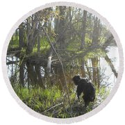 Dog Exploring Mississippi River Bank Round Beach Towel