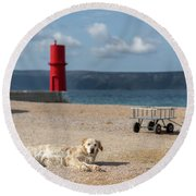 Dog Lying On The Beach In Front Of Red Lighthouse Of Cres Round Beach Towel