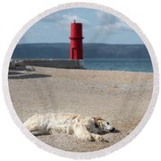 Dog Sleeping On The Beach In Front Of Red Lighthouse Of Cres Round Beach Towel