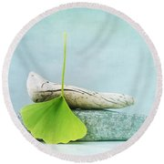 Driftwood Stones And A Gingko Leaf Round Beach Towel