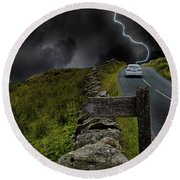 Driving Into The Storm Round Beach Towel
