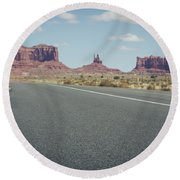 Driving Monument Valley Round Beach Towel