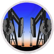 Dueling Oil Well Pumps Round Beach Towel