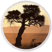 Dusty Sunset Over The Mara Round Beach Towel