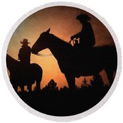 Early Morning Cowboys Round Beach Towel