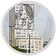 Eva Peron Outlined On The Wall Of A Skyscraper On July Nine Avenue  In Buenos Aires-argentina Round Beach Towel