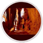 Exploring A Cave Round Beach Towel