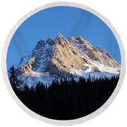 Fading Afternoon Sun Illuminates Mountain Peak  Round Beach Towel