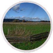 Fence And Open Field Round Beach Towel
