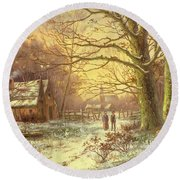 Figures On A Path Before A Village In Winter Round Beach Towel