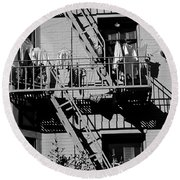 Fire Escape With Clothes Hung To Dry Round Beach Towel