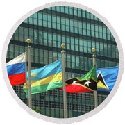 Flags Of Various Nations Outside The United Nations Building. Round Beach Towel