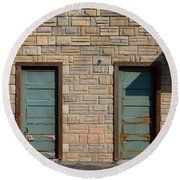 Flagstone Wall And Two Green Doors Round Beach Towel