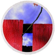 Flora And The Red Fence Round Beach Towel