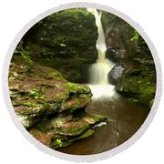 Flowing Toward The Red Rocks Round Beach Towel