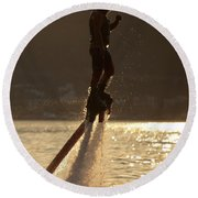 Flyboarder And Water Droplets Backlit At Sunset Round Beach Towel