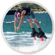 Flyboarder Bending Over To Dive Into Water Round Beach Towel